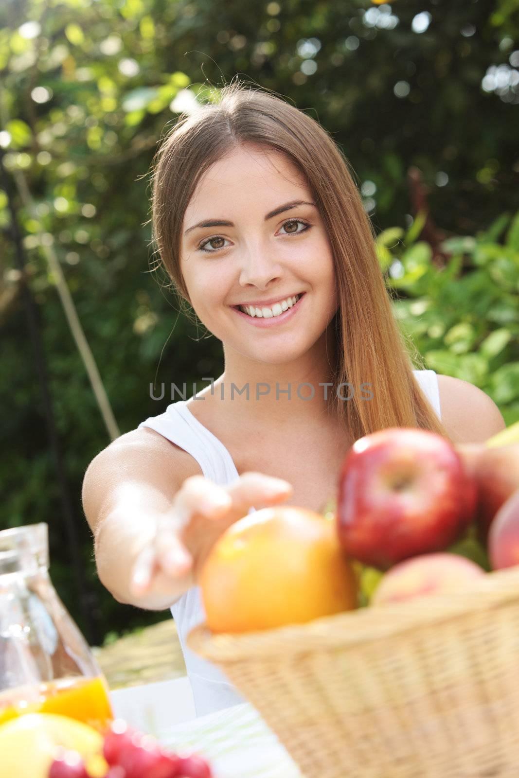 Portrait of a beautiful girl taking an apple