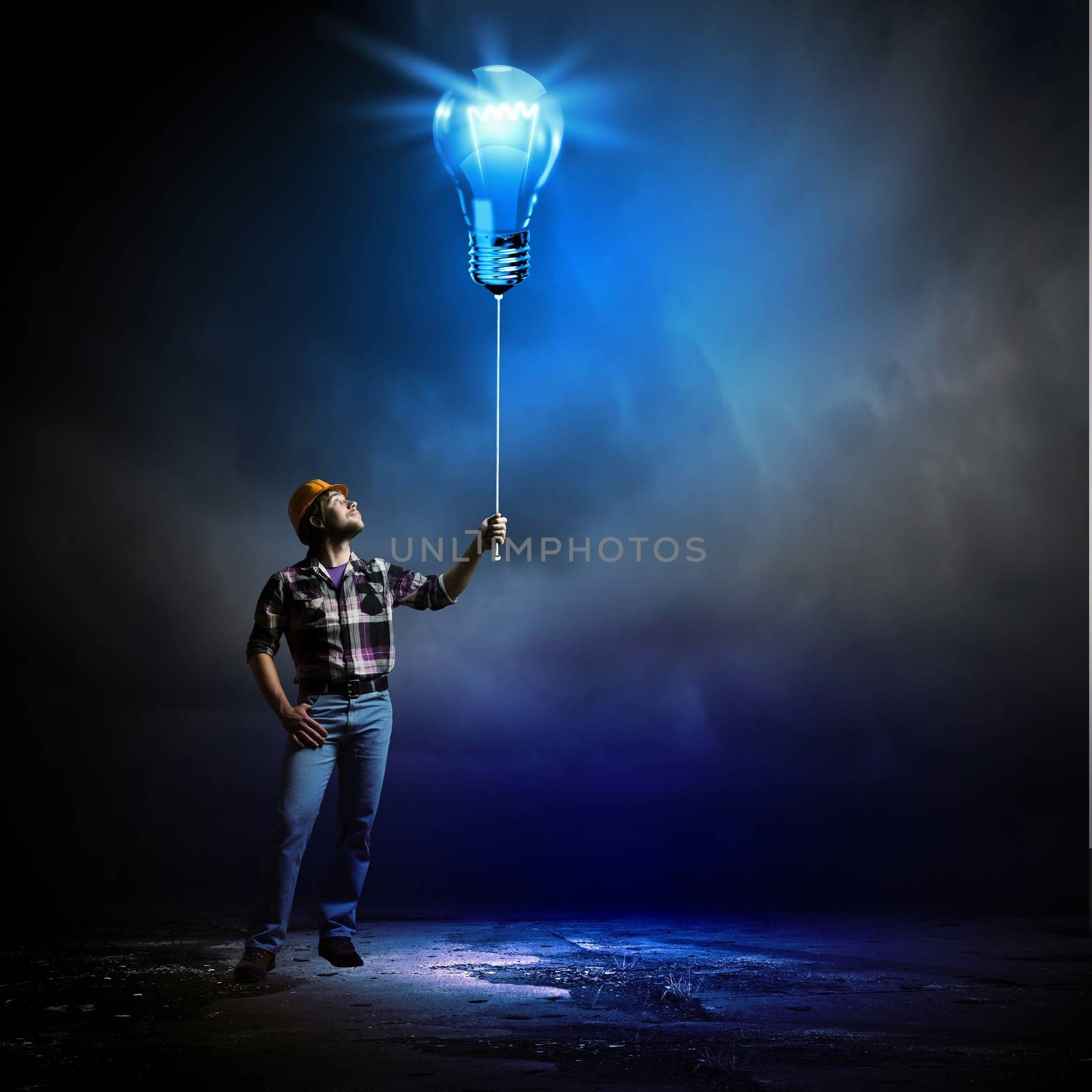 Image of man builder holding electrical bulb