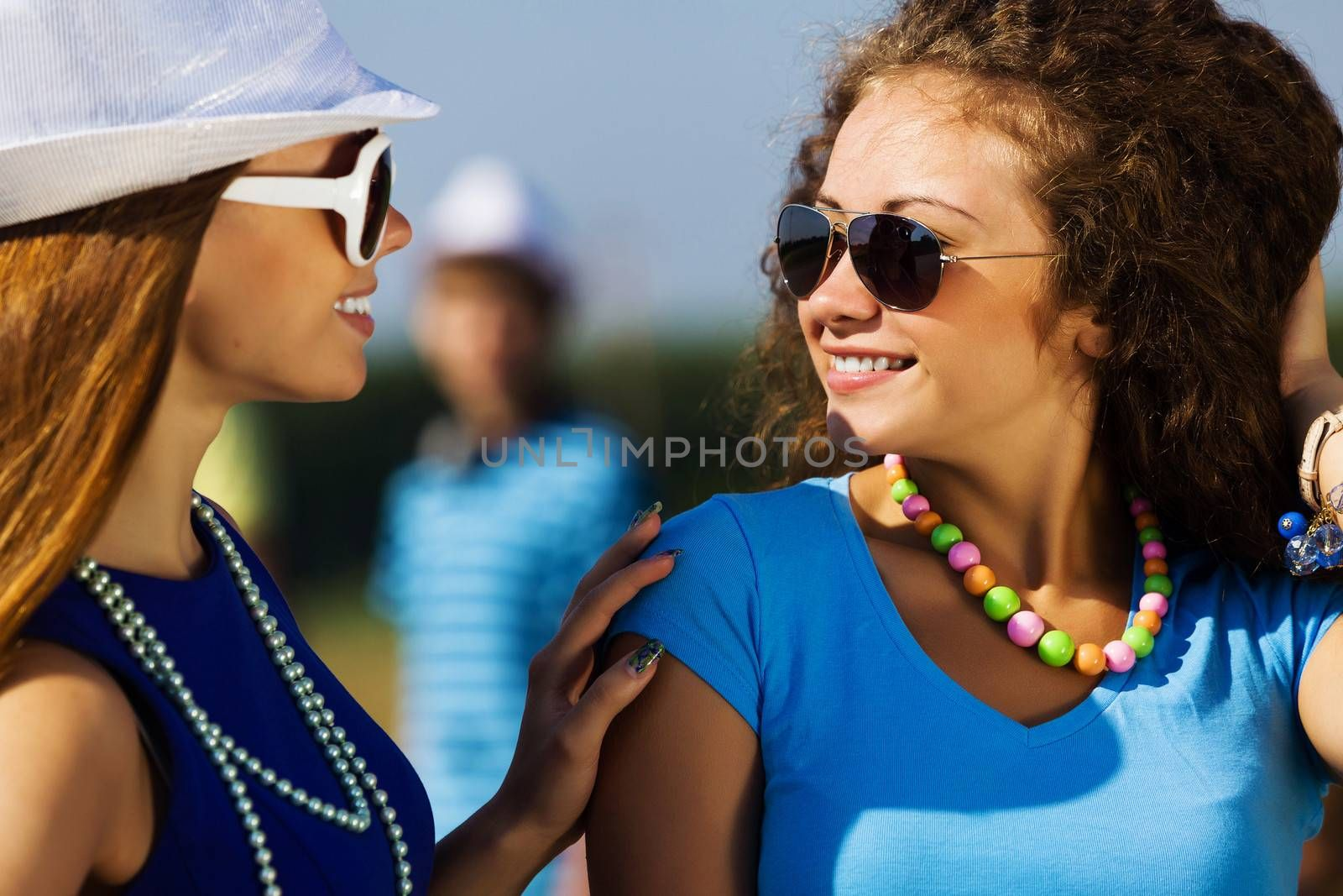 Attractive young women having fun outdoors. Summer vacation