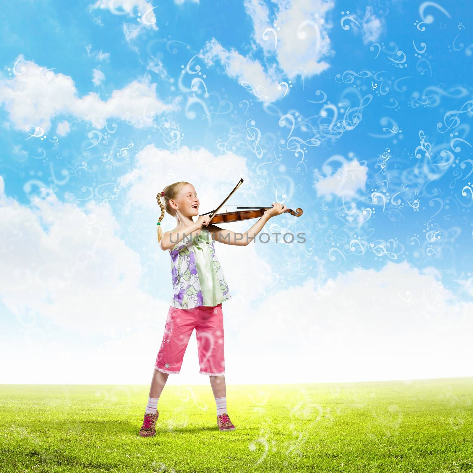 Image of cute girl playing violin outdoors