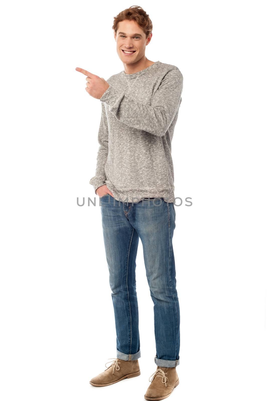 Fashion guy pointing at something