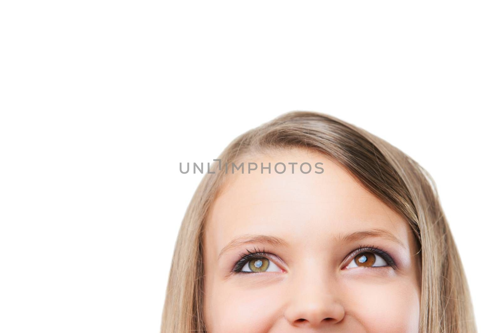 Close-up portrait of a beautiful teenager. Looking up into the copy space