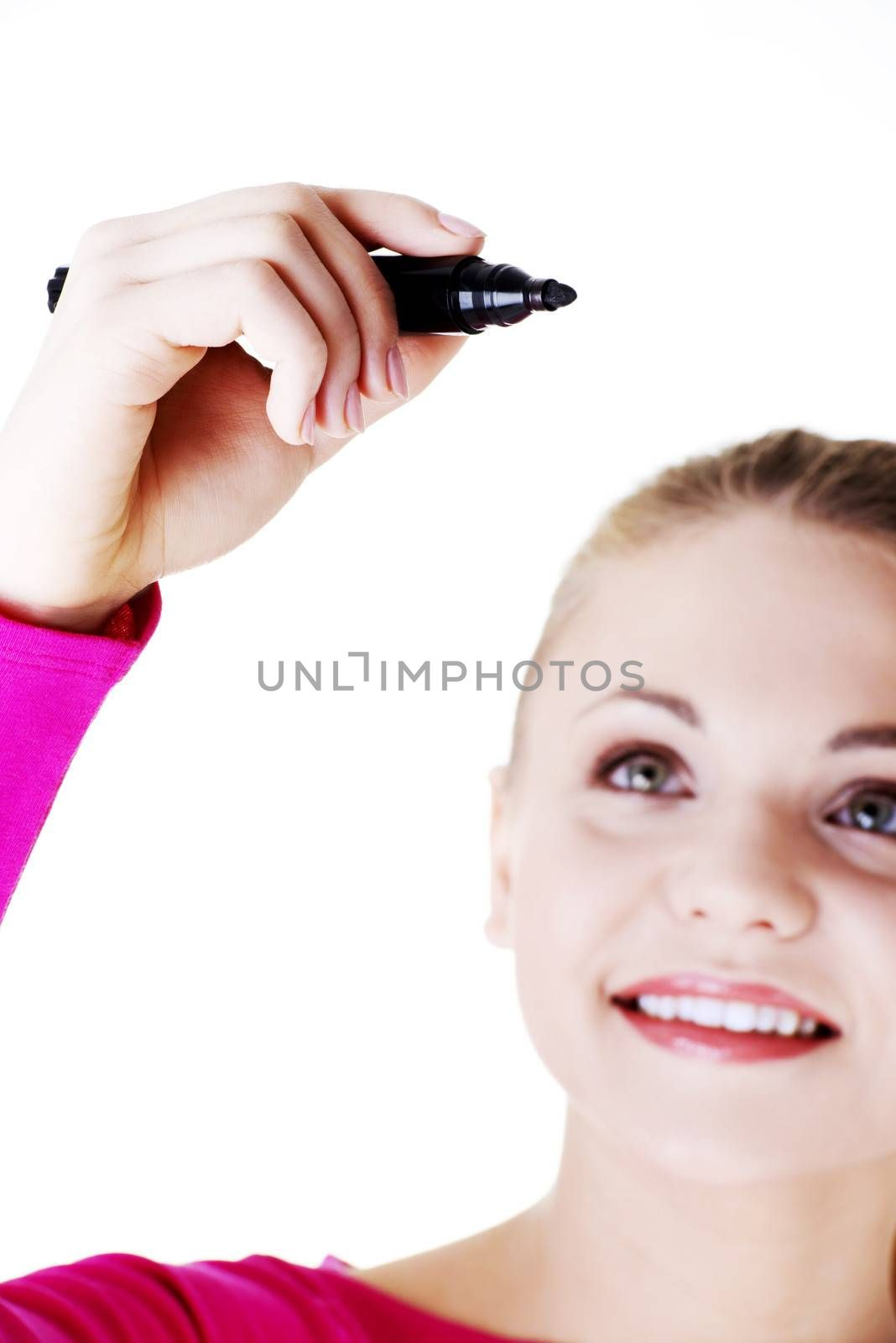 Beautiful caucasian blond woman writing on copy space. Focus on hand. Isolated on white.