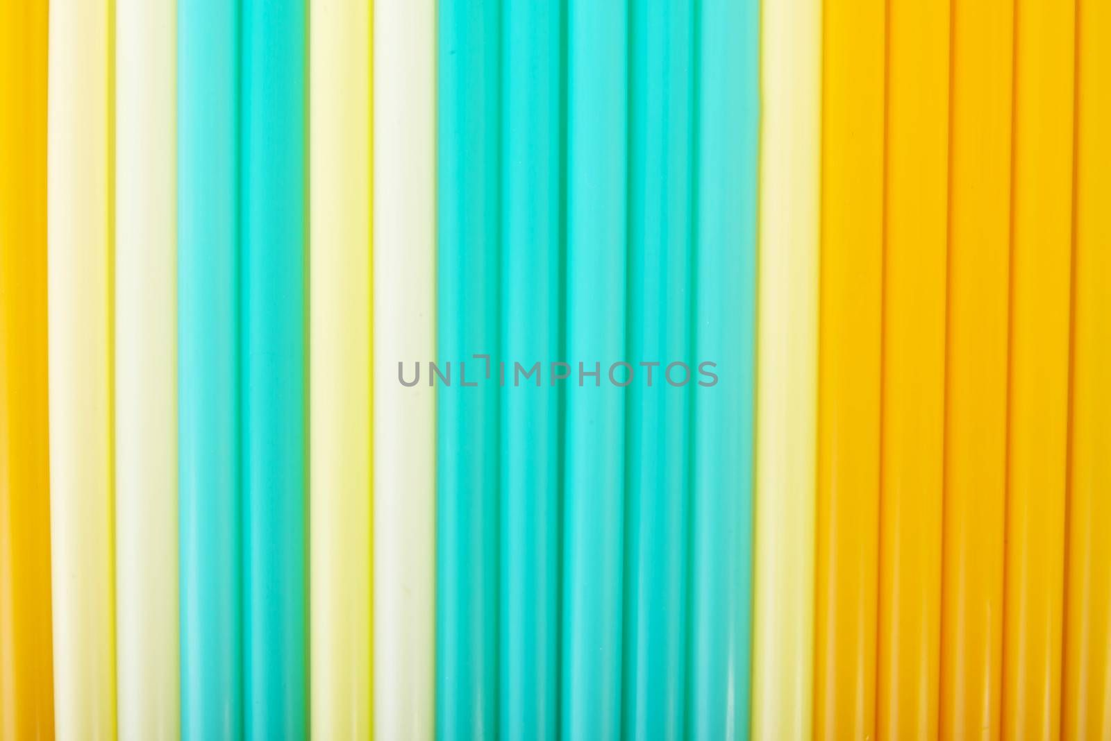 Composition of colorful straws. Blue, yellow or white.