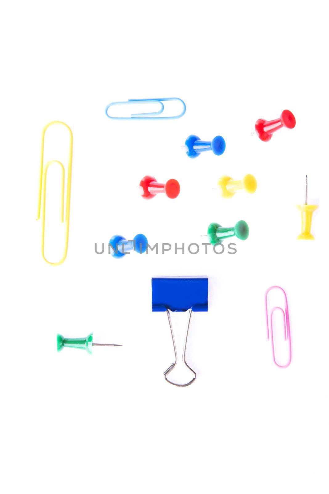Colorful office equimpent- clips and drawing pins.