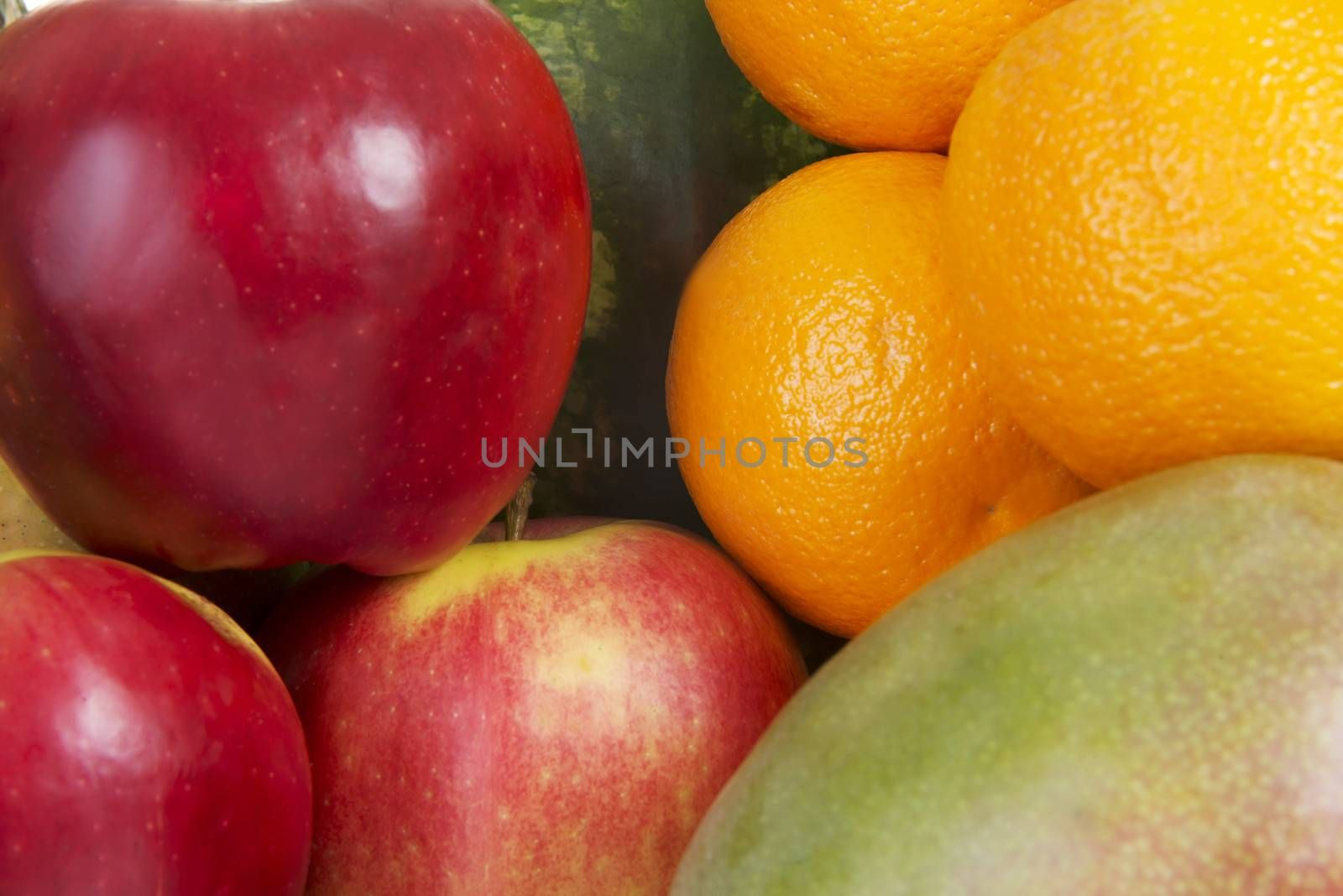 Close up on fresh fruits: mango, oranges,grapes, coconut,apples.