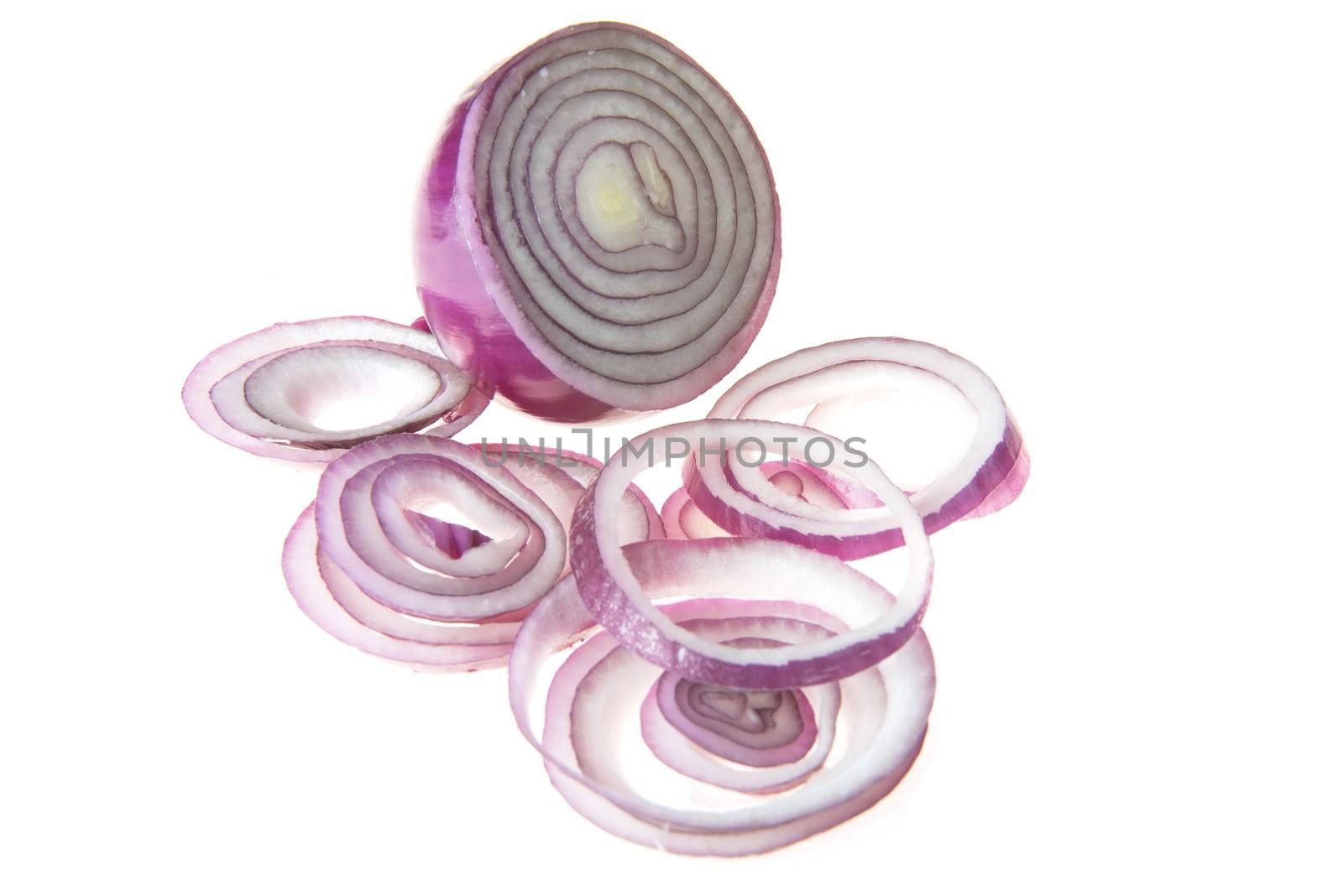 Raw red sliced onion over white background.