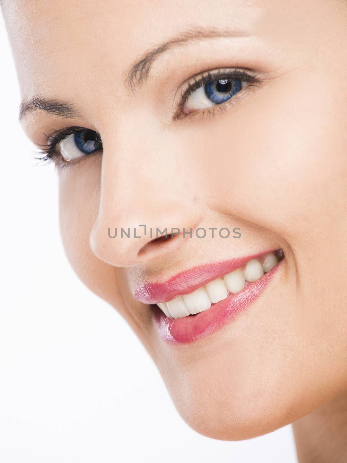 Beauty portrait of a young blonde woman, isolated on white background