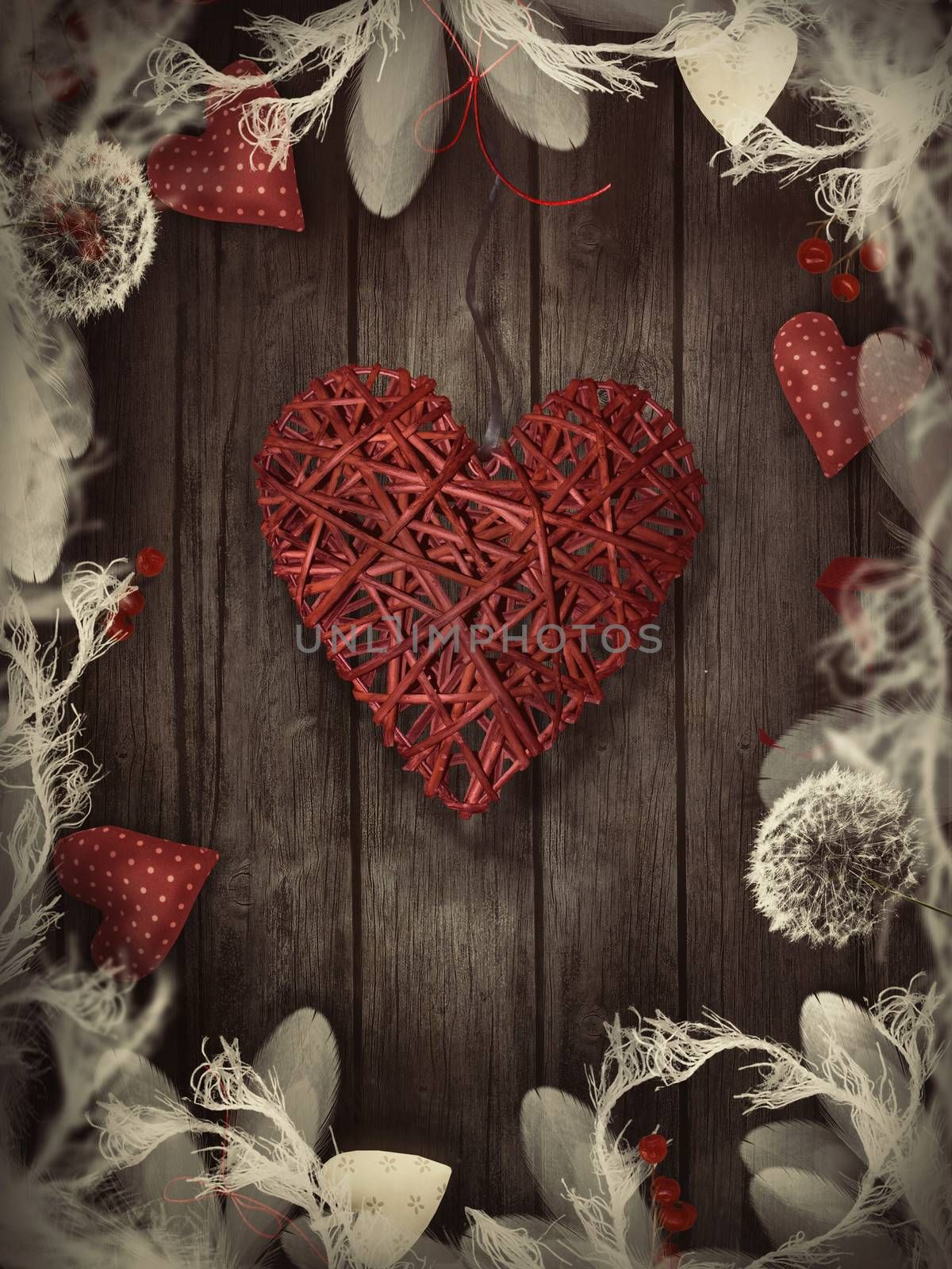 Valentines design - Love wreath with copyspace on wooden background. Valentines ornaments on wood with hearts and ribbons.