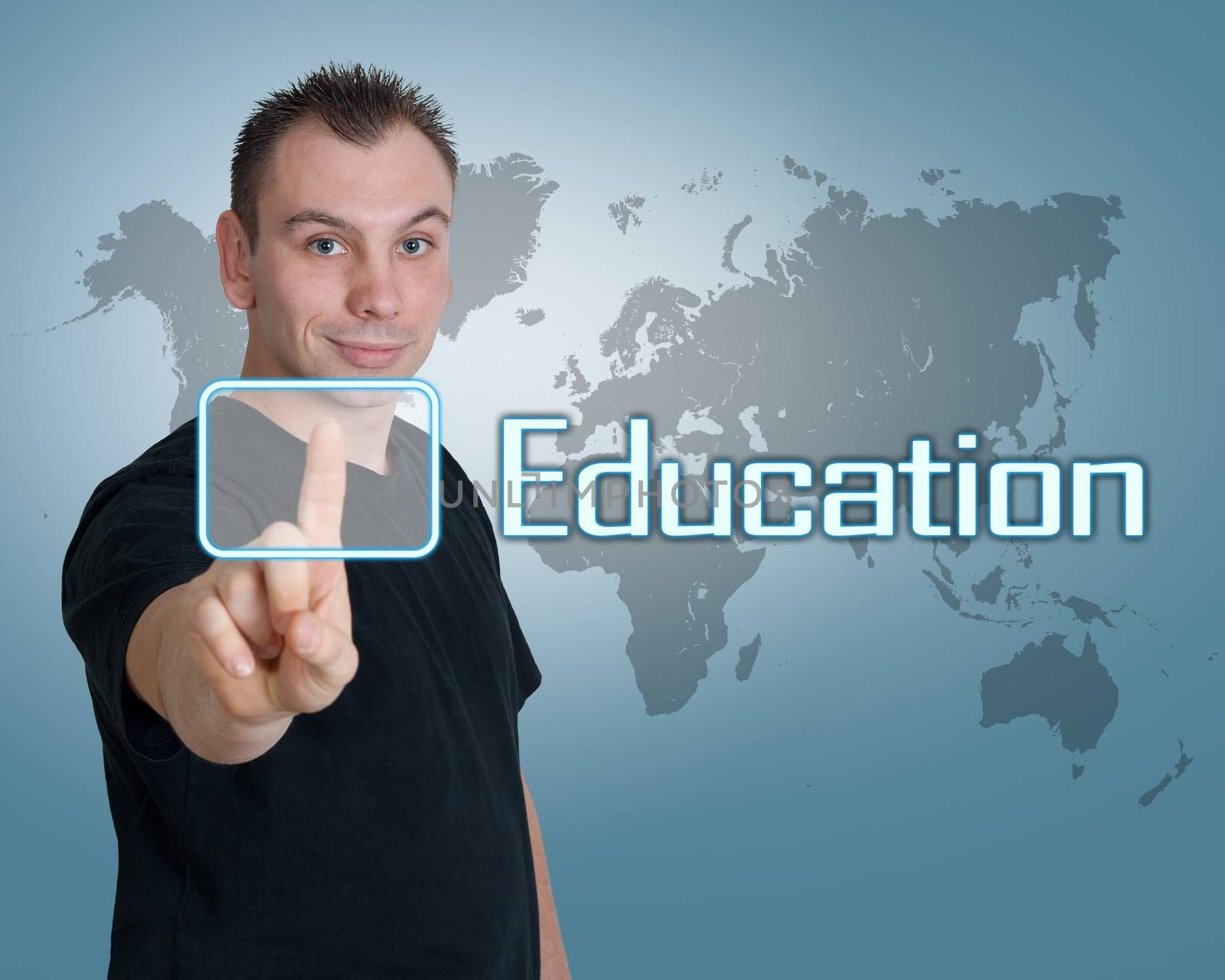 Young man press digital Education button on interface in front of him