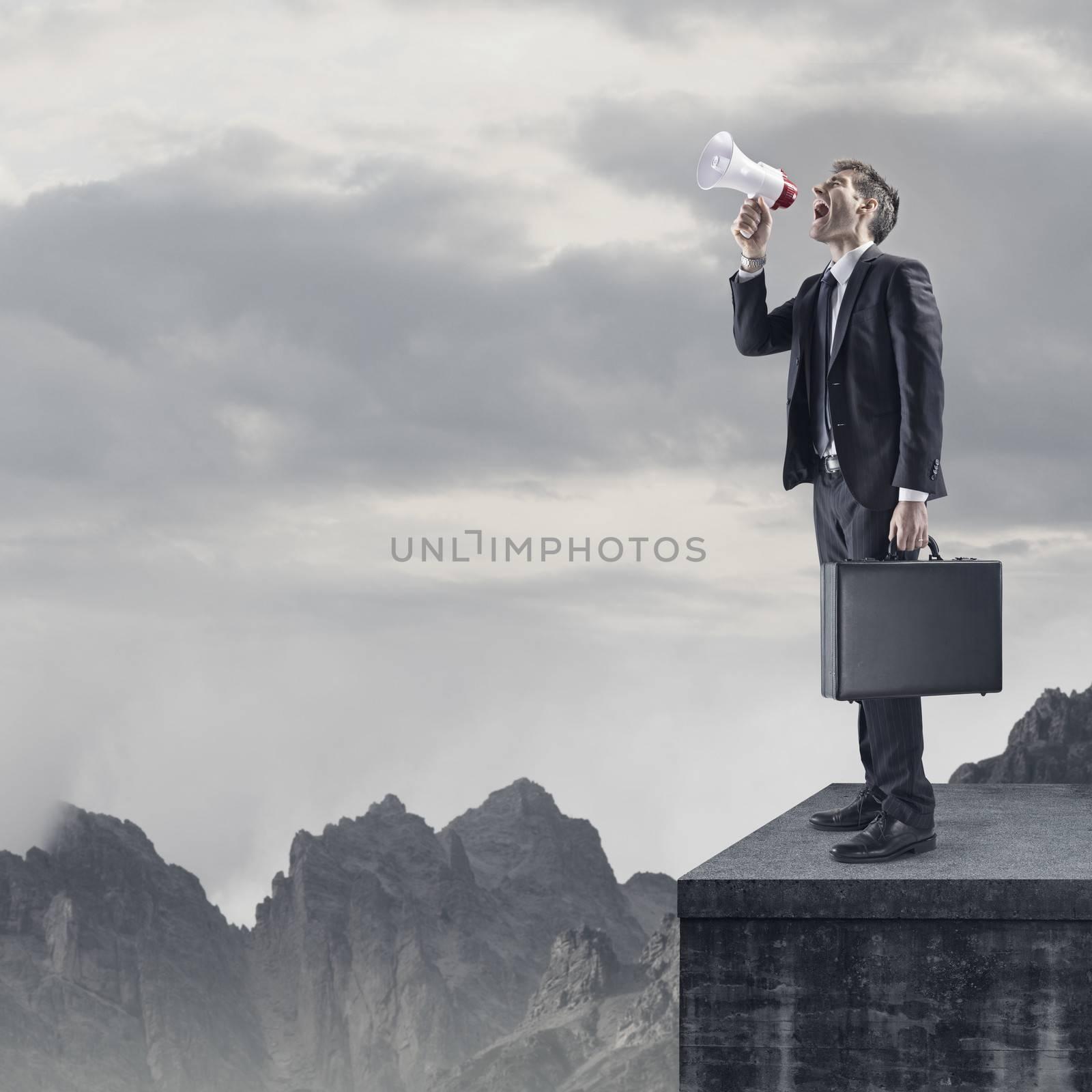 Young Businessman Shouting Through Megaphone, copy space