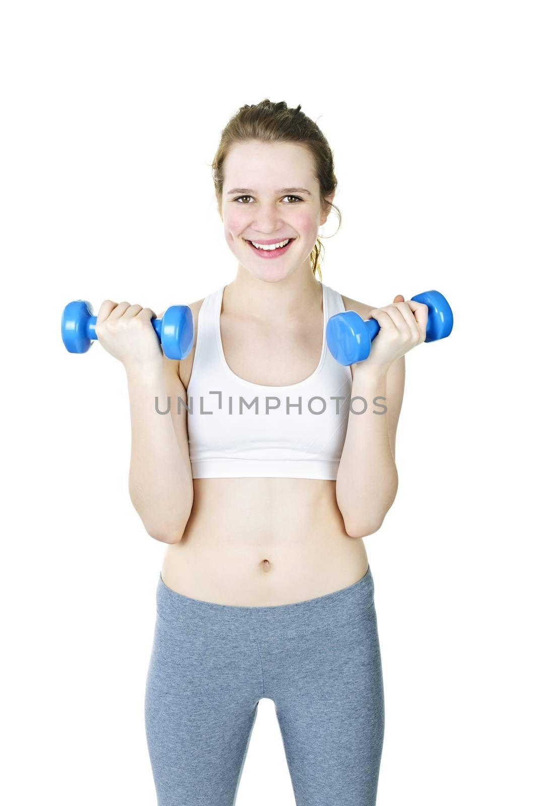 Happy fit young woman working out with weights on white background