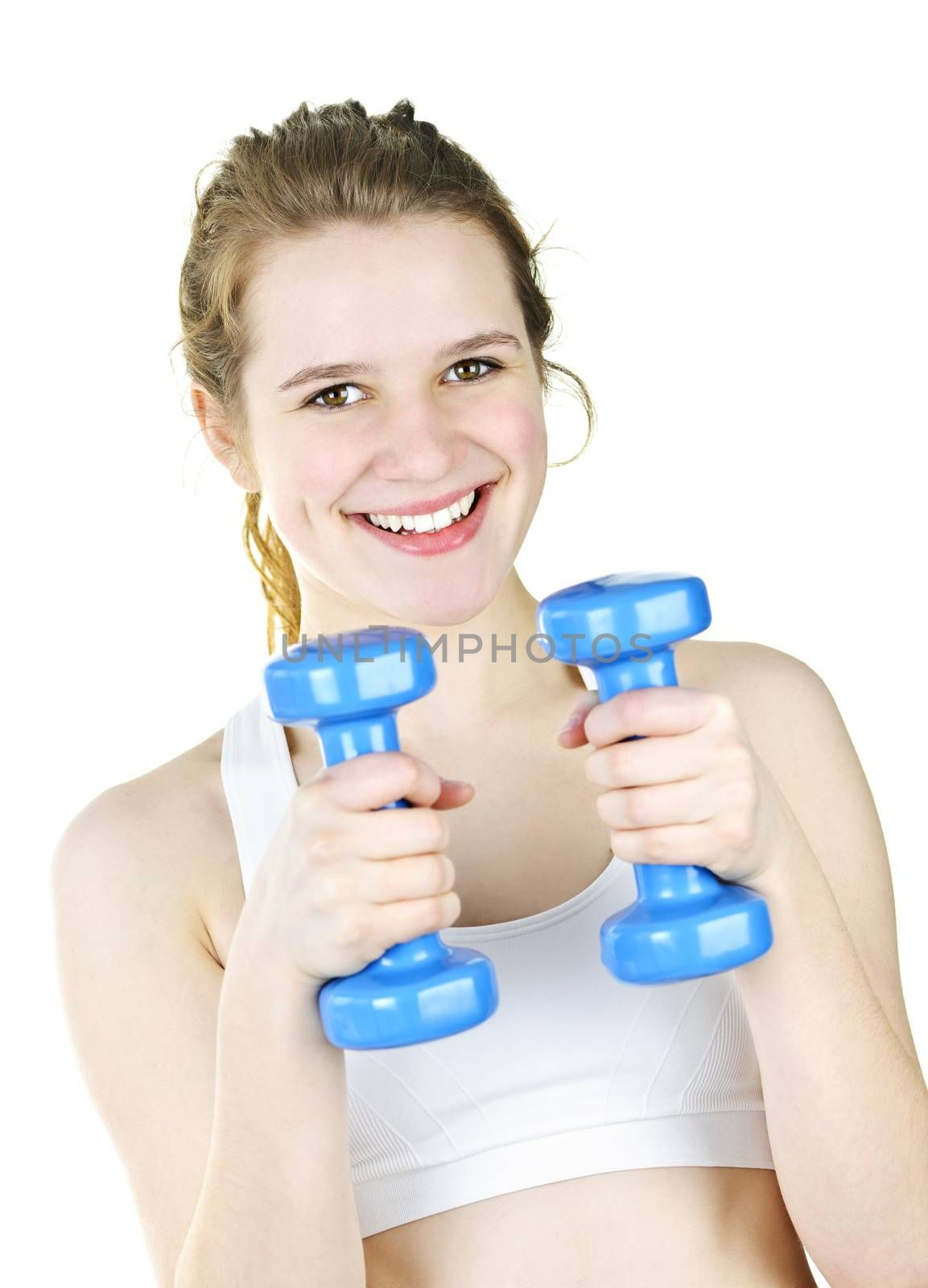 Happy fit young woman working out with weights for fitness exercise