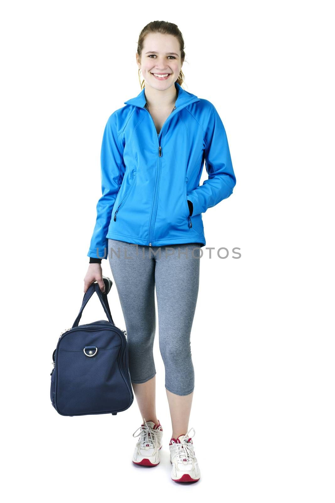 Smiling fit young woman with gym bag standing ready for fitness exercise