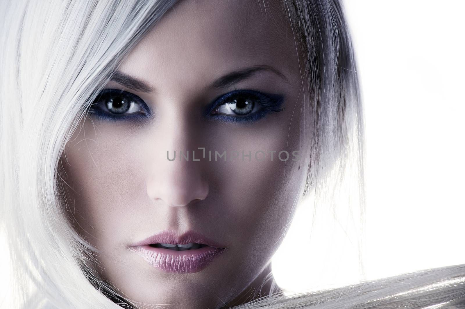 beauty portrait of a cute blond girl with long hair and forced color