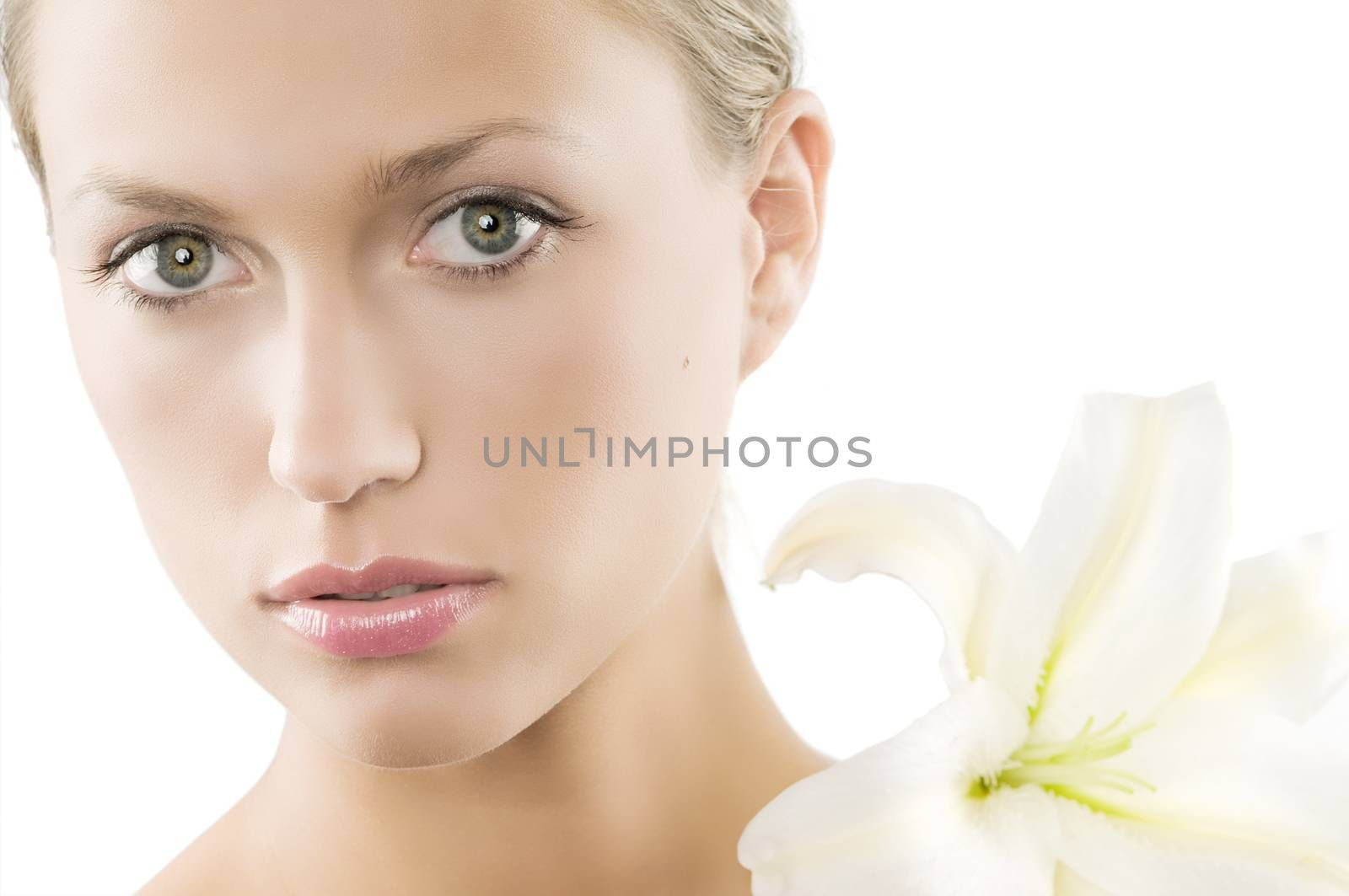 classical beauty portrait high key of a cute girl with a big flower on her shoulder