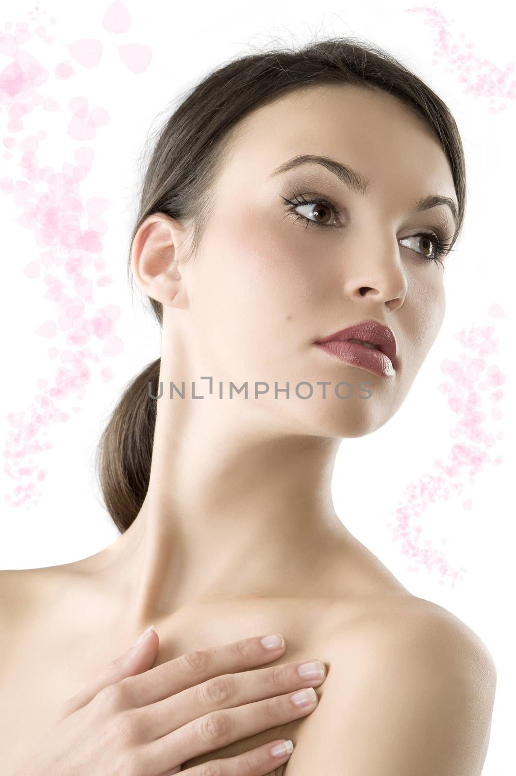 portrait of a young and beautiful brunette with natural makeup looking over