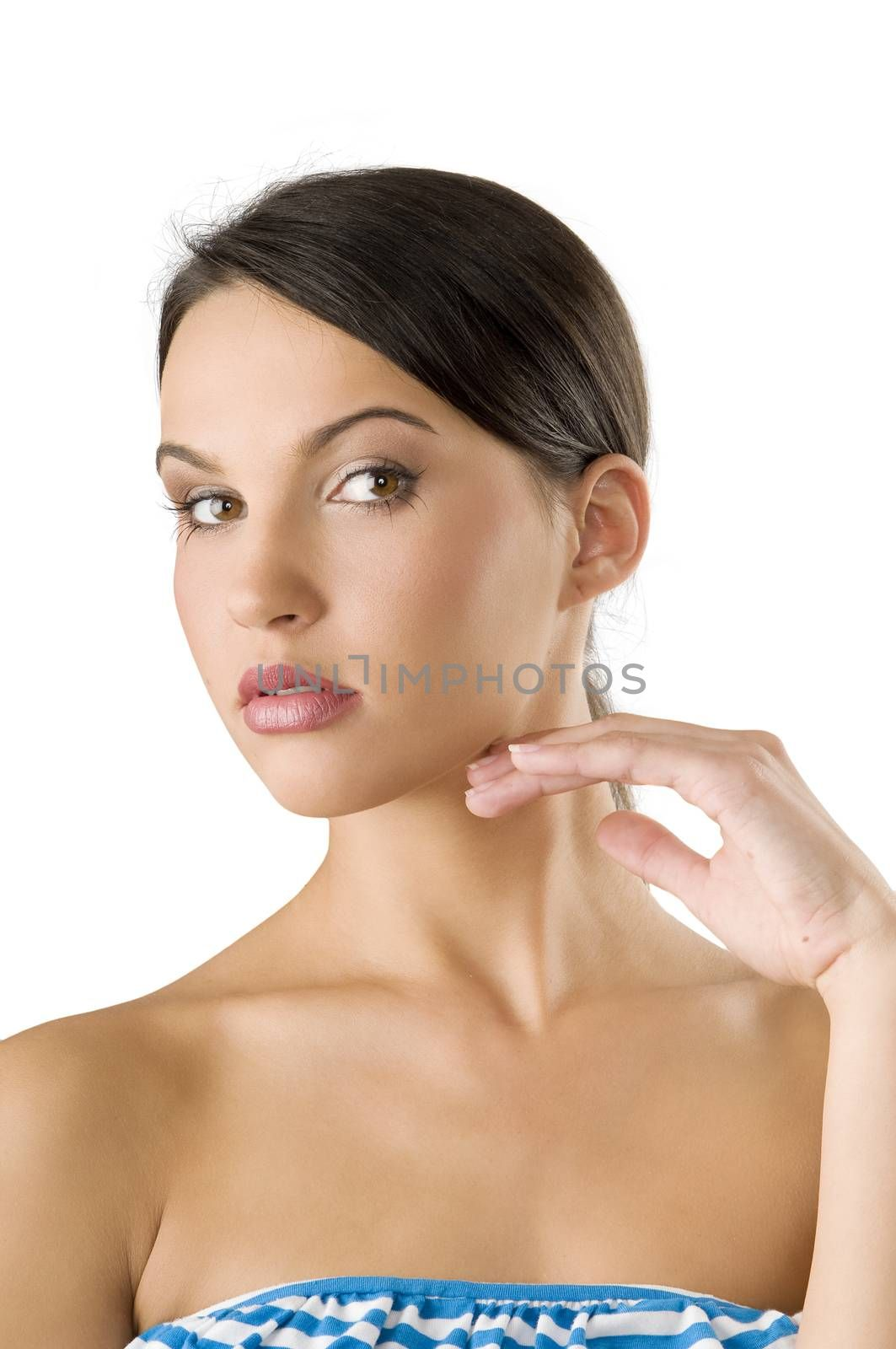 potrait of a young and beautiful woman with her hand near face