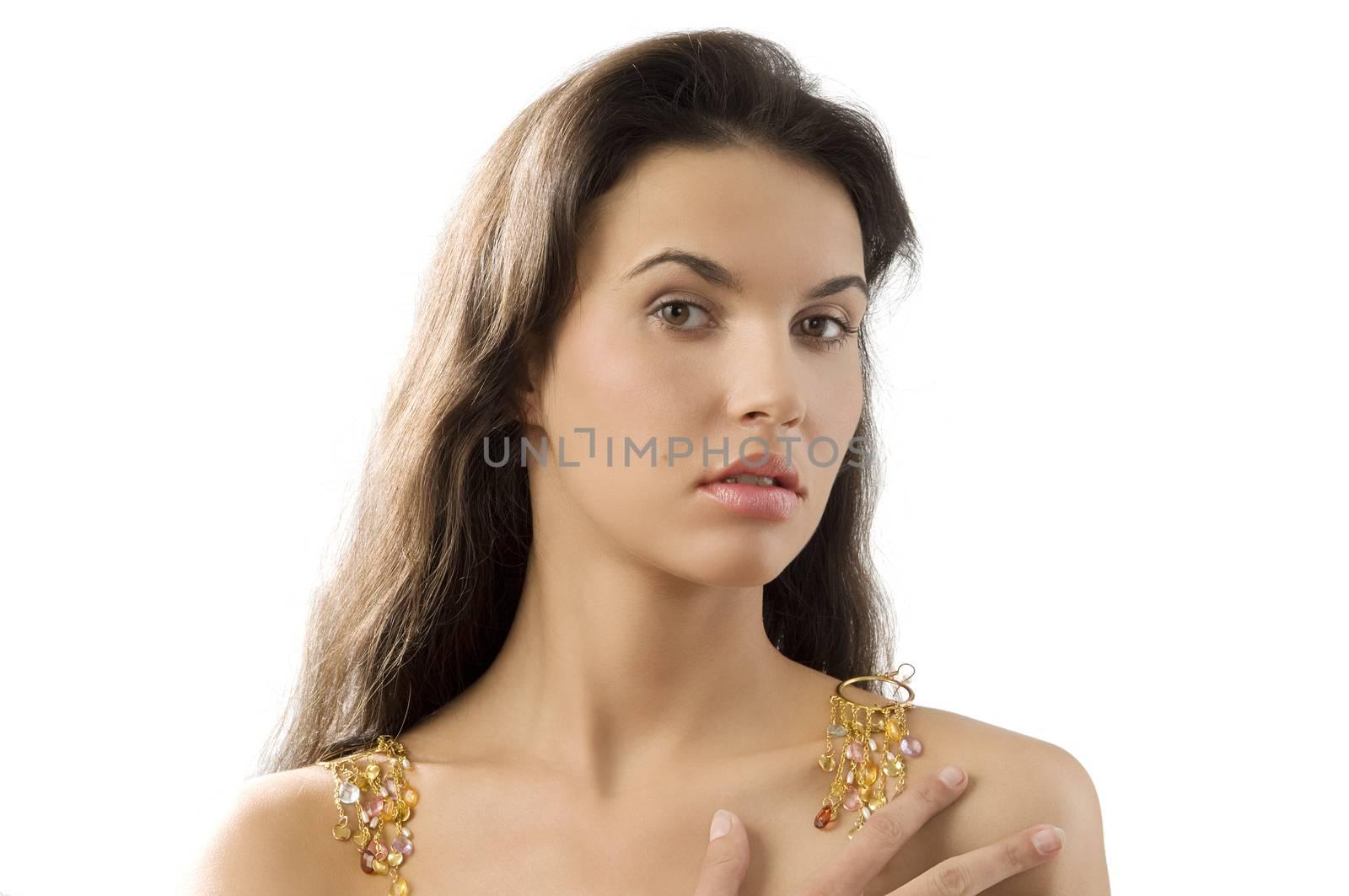 sensual brunette with golden earrings on shoulder