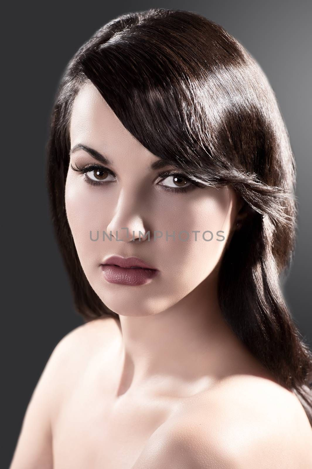 beauty close up portrait of a beautiful long haired brunette with shiny hair
