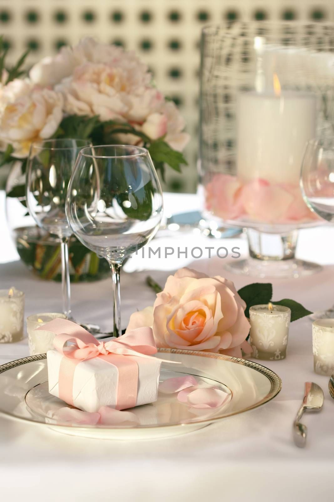 Small gift on plate at wedding reception