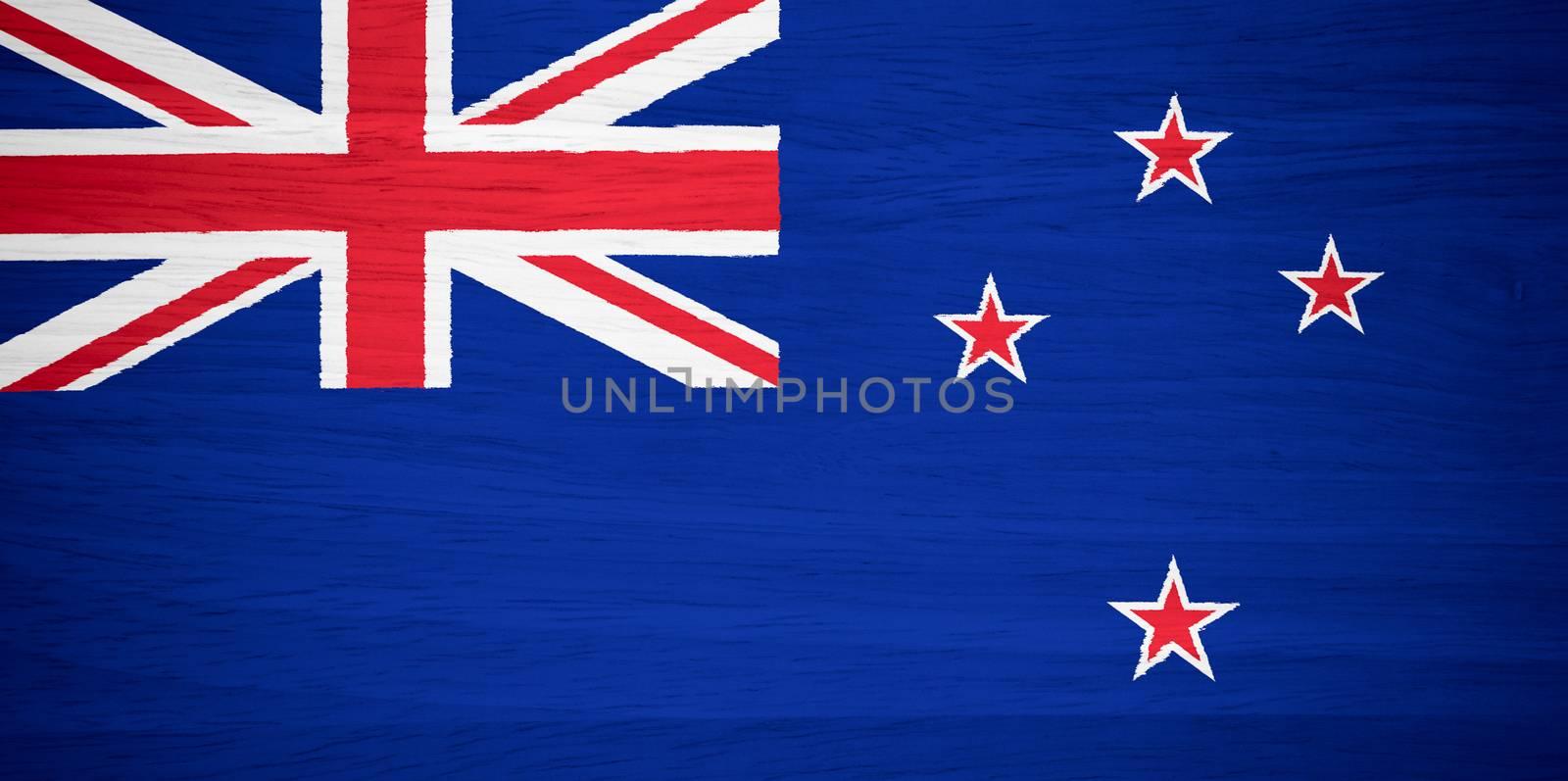 New Zealand flag on wood texture