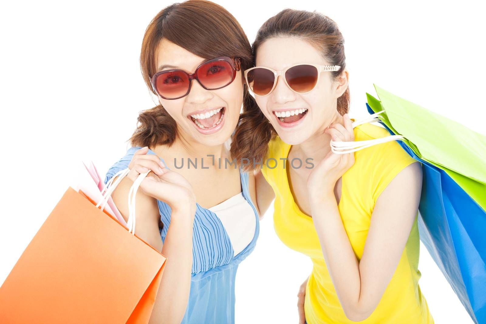 happy fashion young sisters with shopping bags