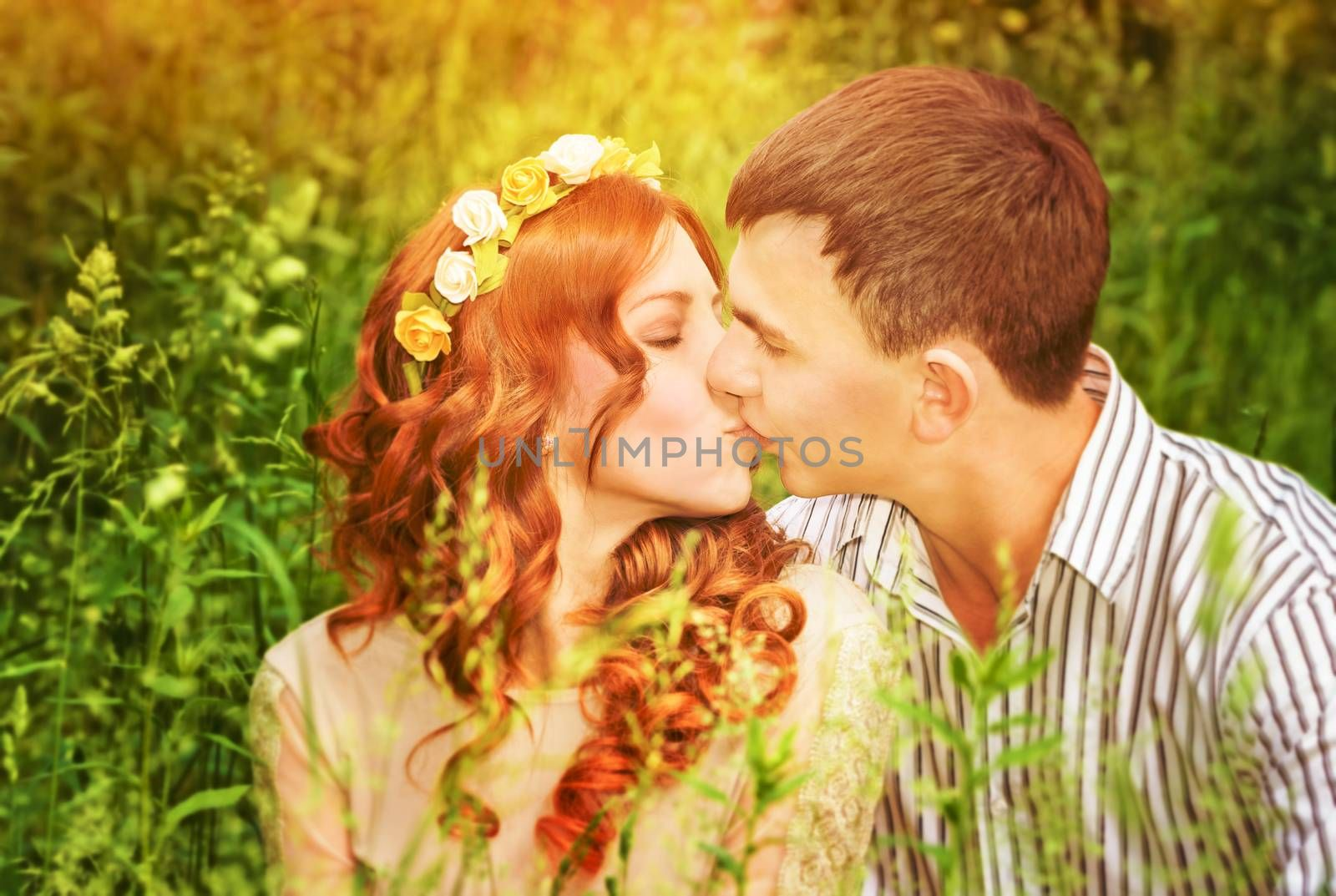 Closeup portrait of gentle young couple kissing outdoors, spending wedding day in the park, romantic date, love concept