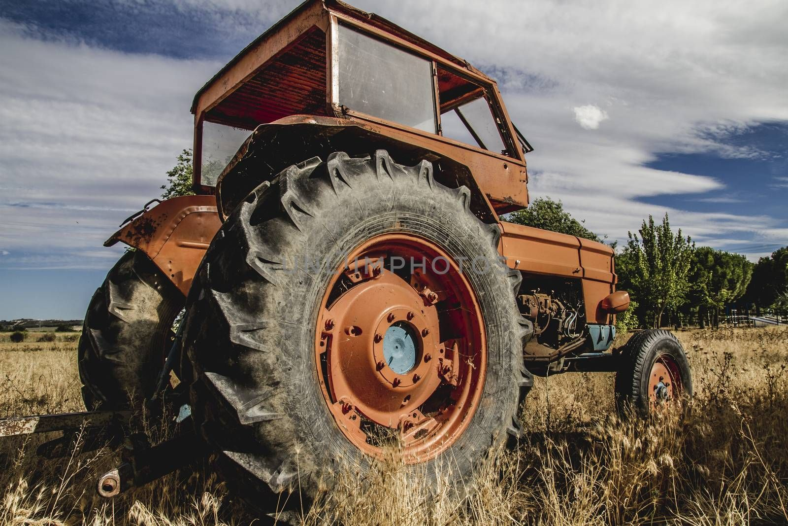 harvest, old agricultural tractor abandoned in a farm field