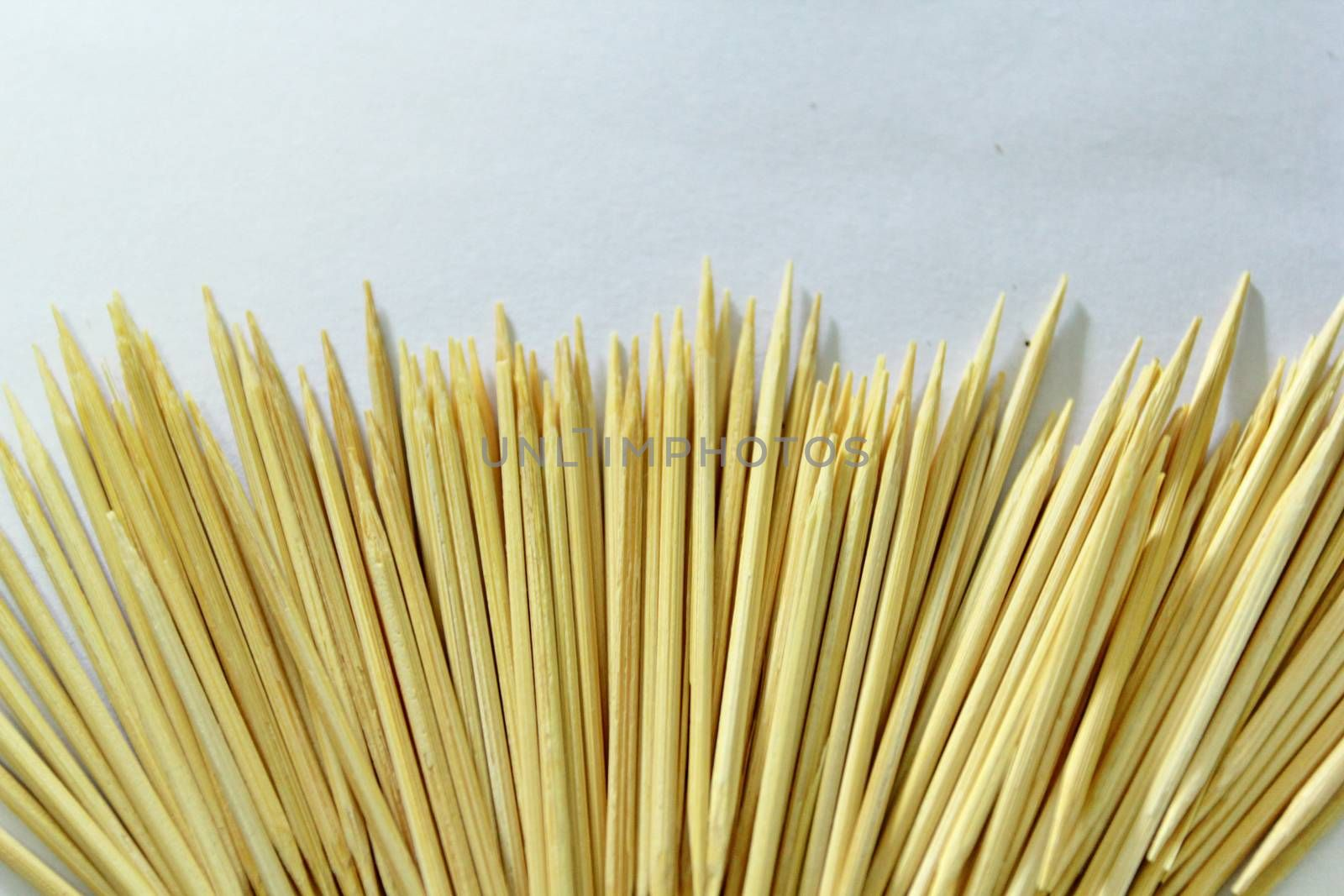 Many toothpicks are on the ground.They cannot be use.