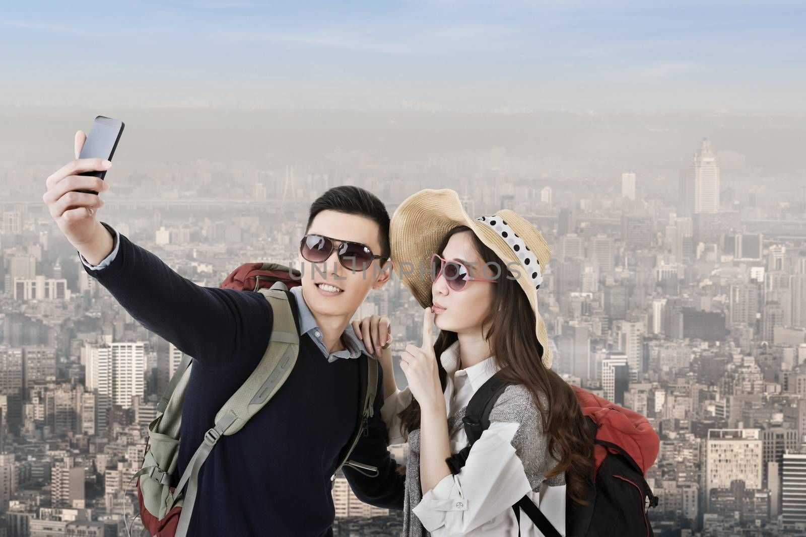 Asian couple travel and selfie in the city.
