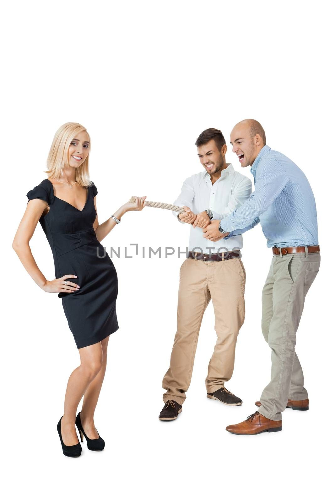 Beautiful strong fit woman demonstrating her dominance in a tug of war with two men pulling as hard as they can on the end of a rope she is holding while she remains nonchalant and glamorous, on white