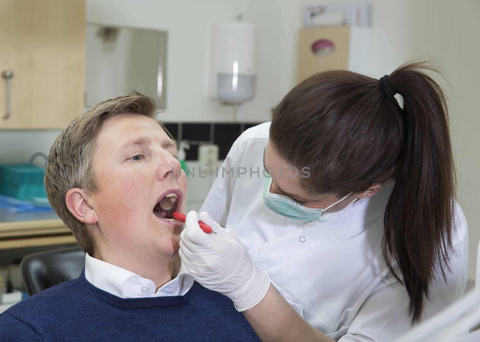 Female Dentist and Male patient
