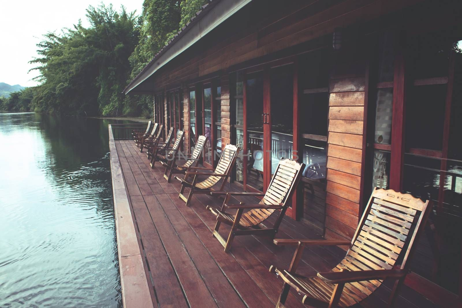 Wooden chairs in floating hotel on the River Kwai in Thailand
