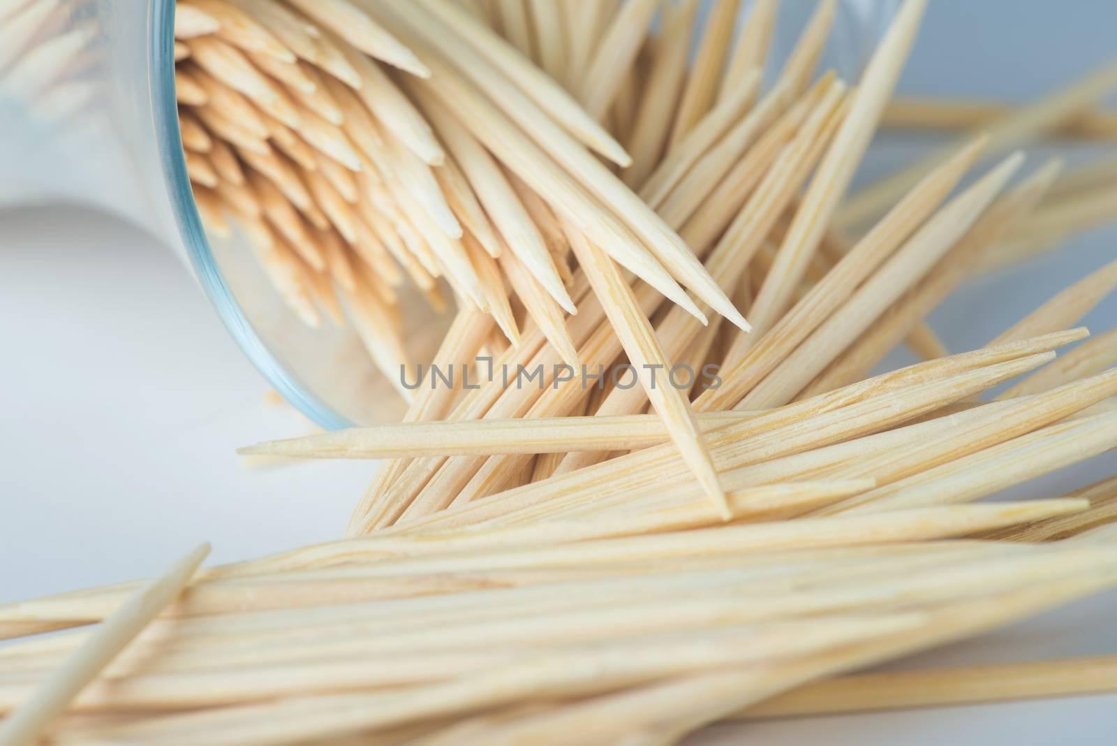 Wooden toothpicks on a light background, closeup