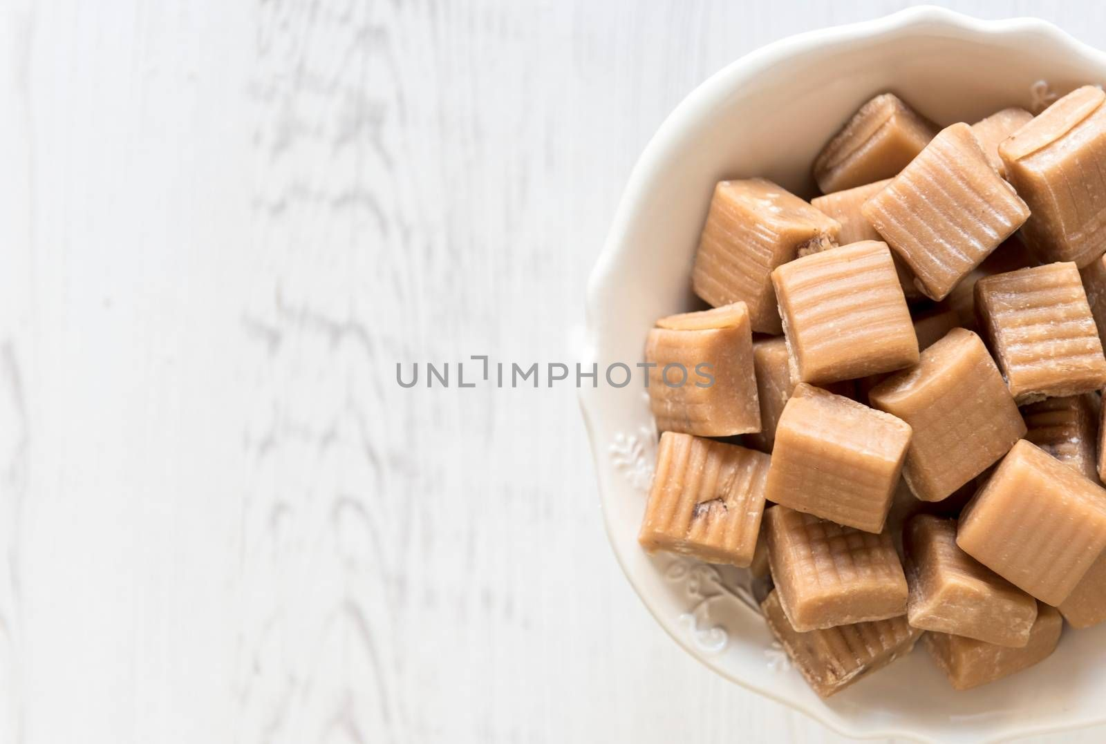 Milk and caramel homemade bonbons and blank space
