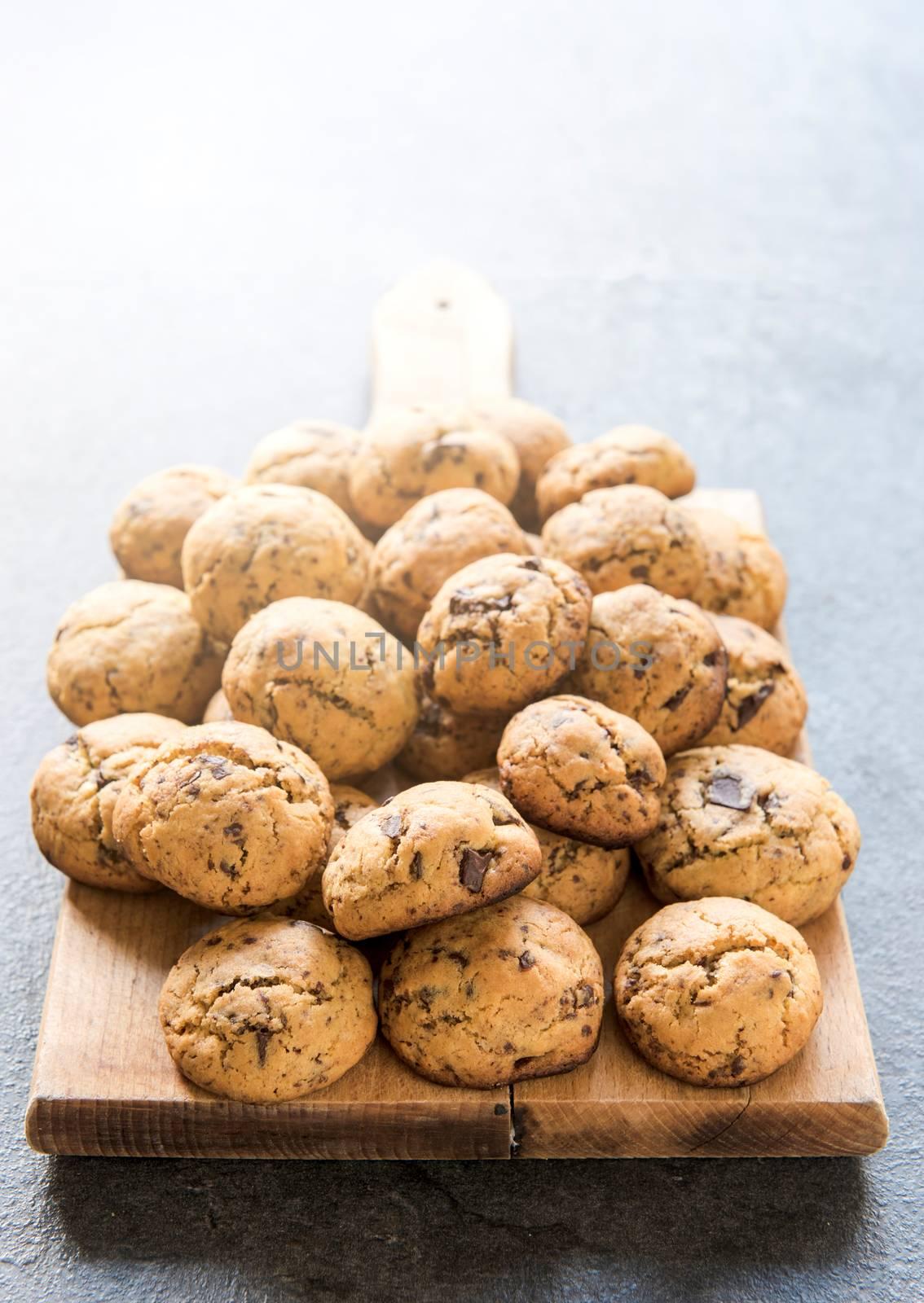 Homemade mini cookies with dark chocolate, selective focus