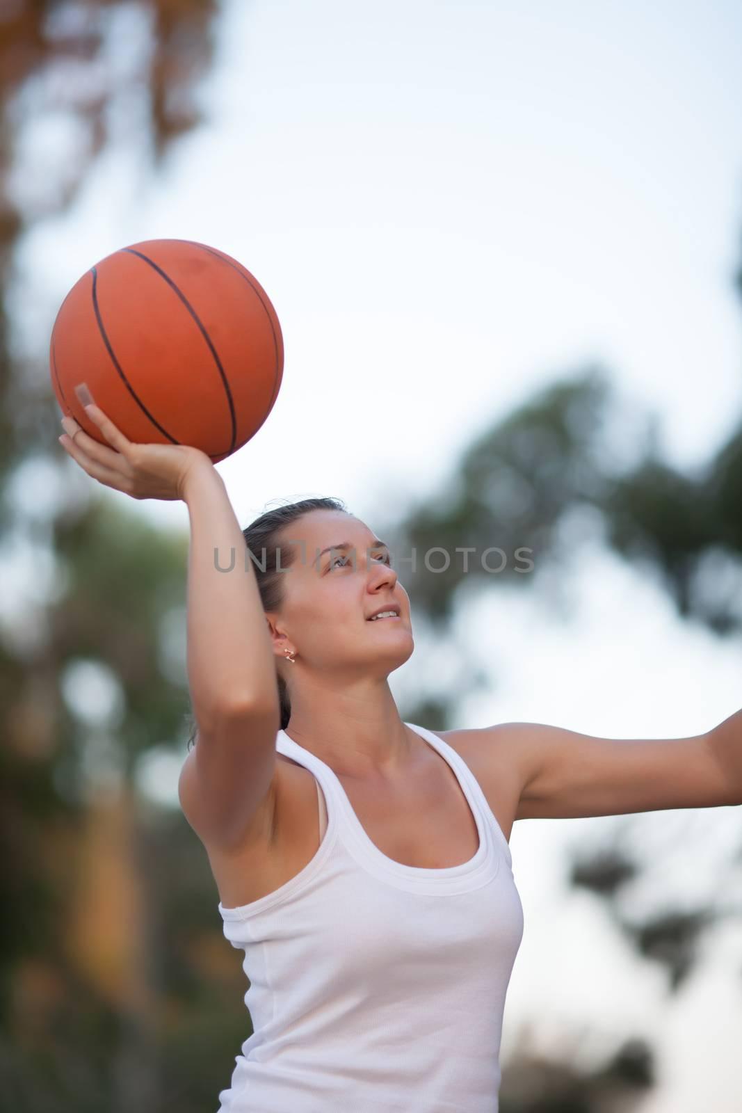 girl plays basketball, a healthy lifestyle