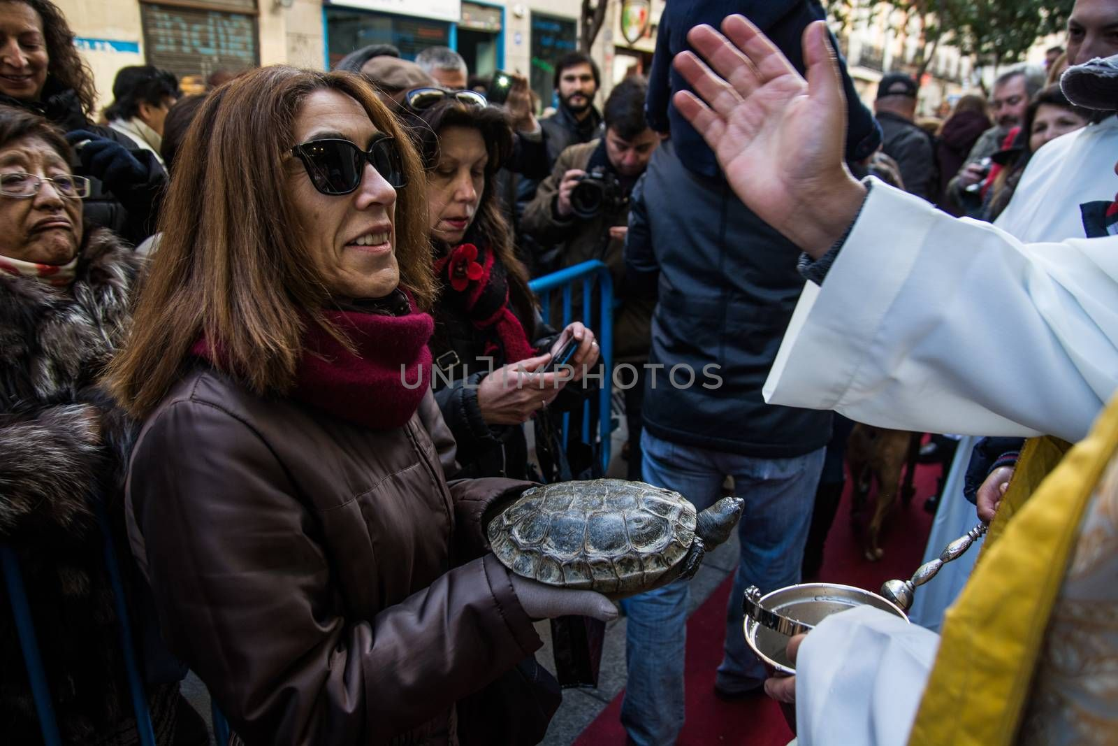 SPAIN, Madrid: A woman holds her pet turtle while it is being blessed by a priest outside the church of San Antón in Calle de Hortaleza in Madrid on Saint Anthony's day, the patron saint of animals, on January 17, 2016.