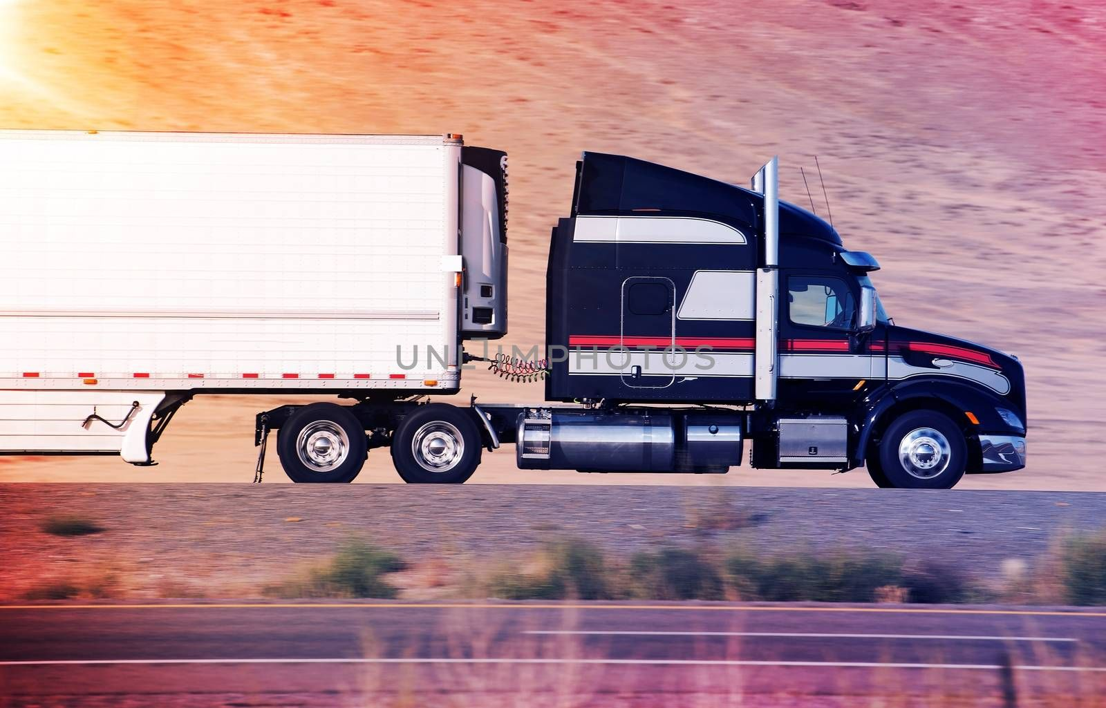 Speeding Semi Truck on a Highway. Heavy Duty Road Transportation Concept.