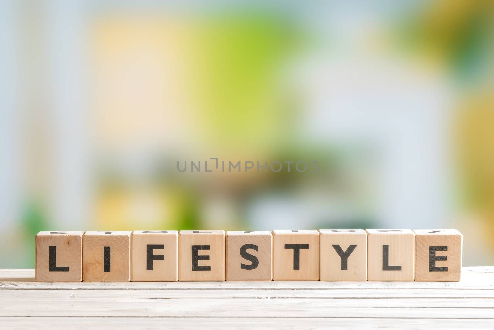 Lifestyle sign with cubes on a wooden table