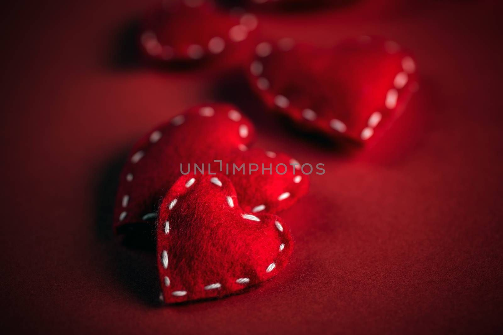 Red felt hearts, symbol of love, romance and friendship for Valentine's Day.