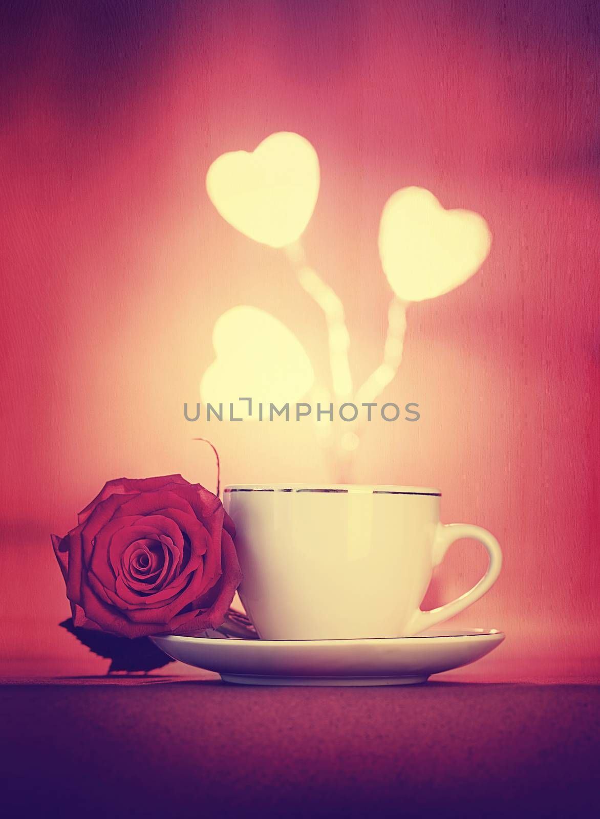 Beautiful romantic still life, morning coffee decorated with fresh rose flower and glowing hearts over red background, vintage style greeting card for Valentine day