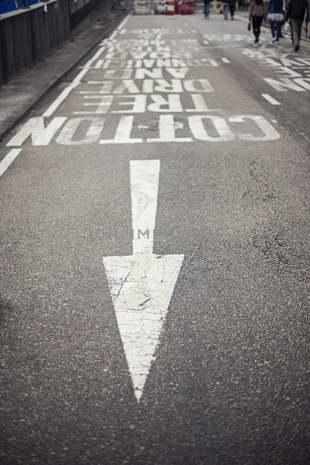 Road markings with arrow on asphalt. Travel and transportation concepts