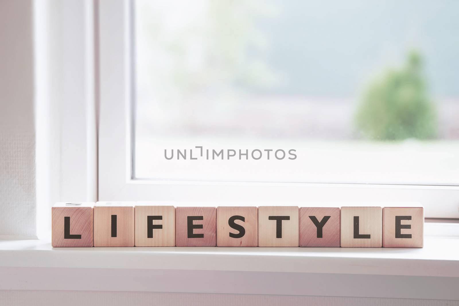 Lifestyle sign in a window in a bright room