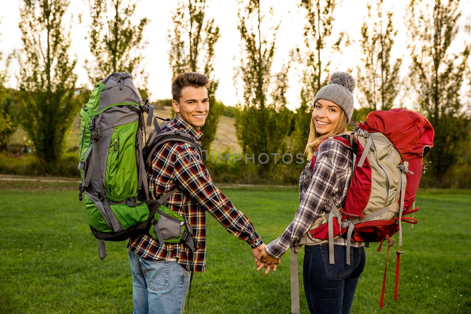 Shot of a young couple with backpacks ready for camping