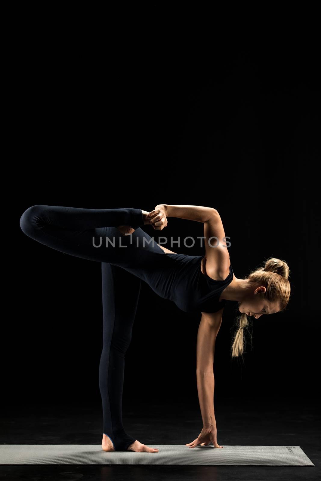 Woman practicing yoga on yoga mat
