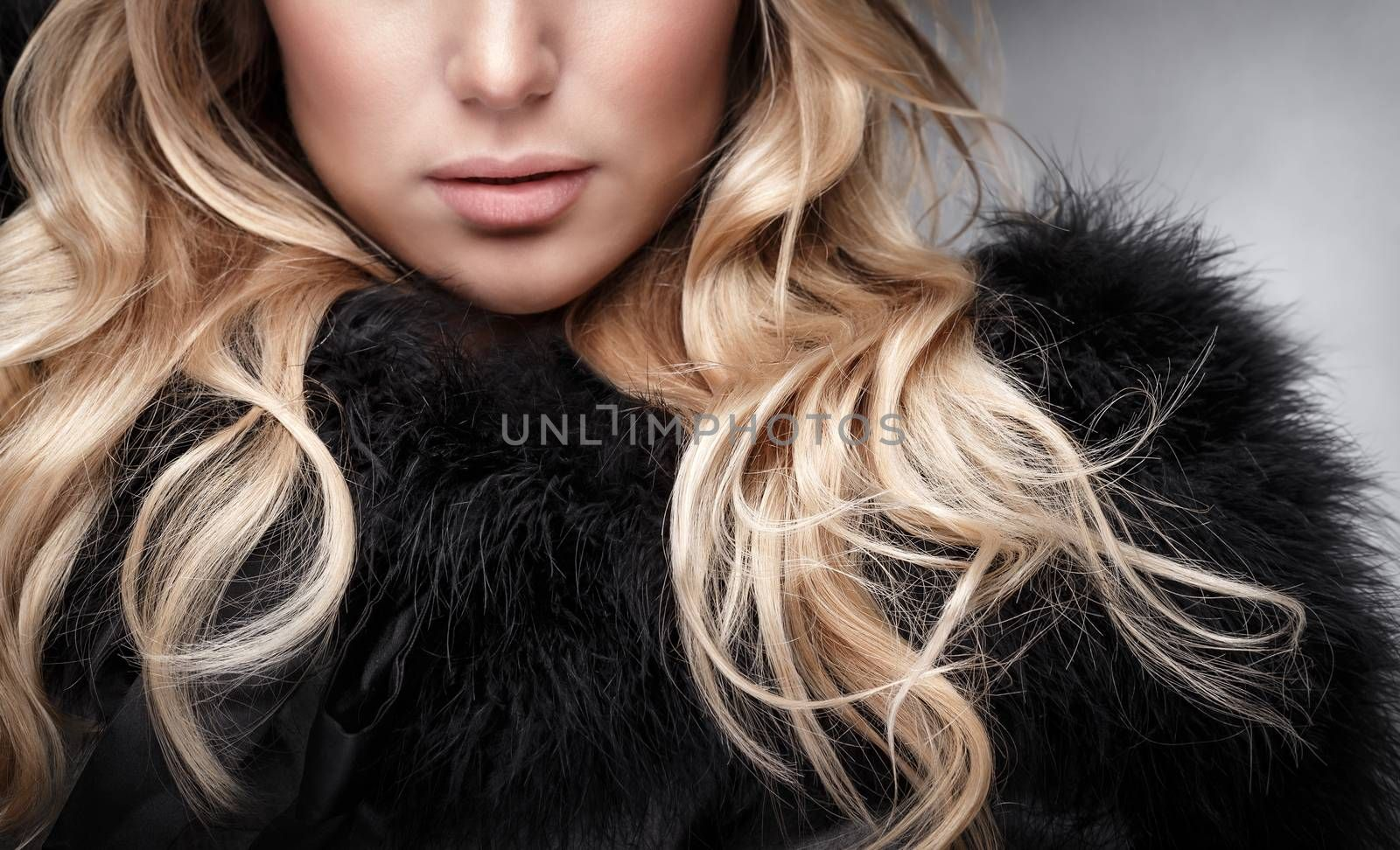 Closeup portrait of beautiful woman with blonde curly hair, face part, glamour fashionable look, luxury beauty salon