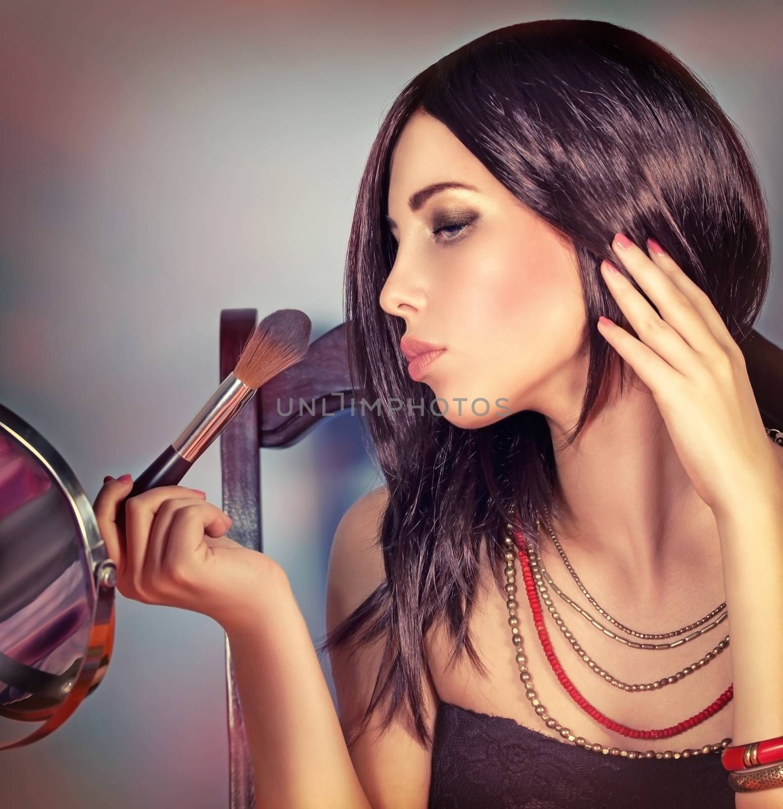Fashion woman portrait, attractive girl looking in the mirror and doing stylish makeup, preparation to party, gorgeous fashionable look
