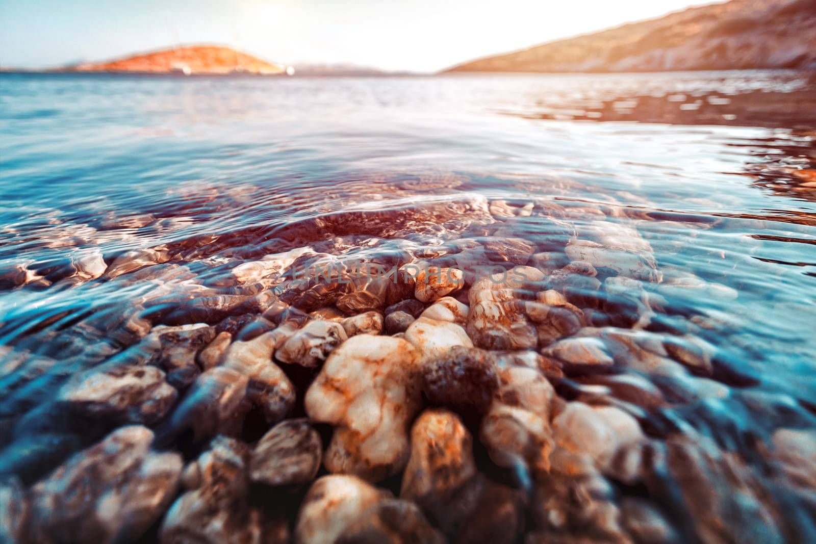 Beauty of underwater nature, the stony bottom is seen through the clear water of the Mediterranean Sea, summer holidays in Greece